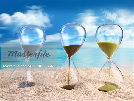 Three hourglass in the sand with blue sky Stock Photo - Budget Royalty-Free, Image code: 400-06203367