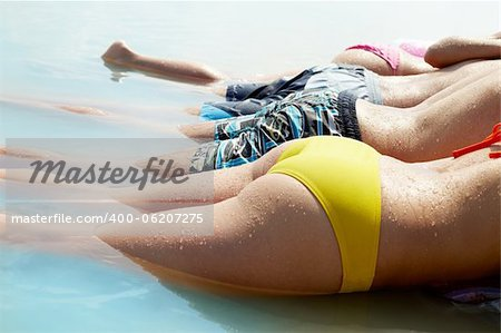 Close-up shot of male and female bodies in summer swimwear Stock Photo - Budget Royalty-Free, Image code: 400-06207275