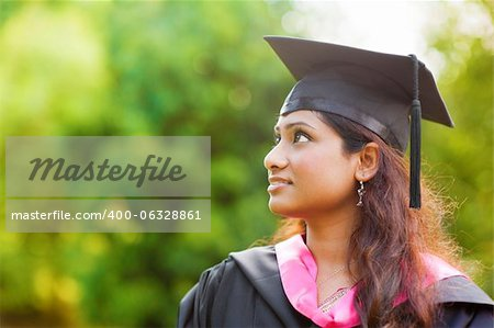 Smiling Young Asian Indian female student looking away with copy space Stock Photo - Budget Royalty-Free, Image code: 400-06328861