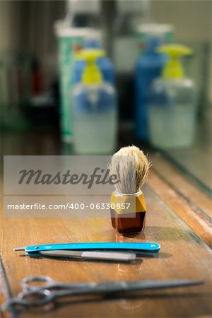 Closeup of barber tools, shaving brush, scissors and razor on shelf in barber shop Stock Photo - Budget Royalty-Free, Image code: 400-06330957