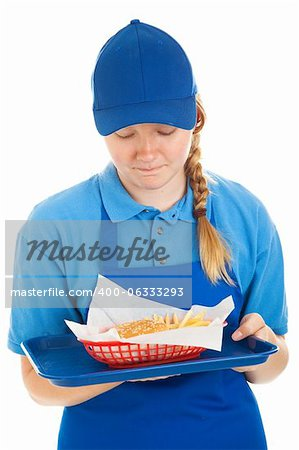 Teenage fast food worker disgusted by the burger and fries she's serving.  Isolated on white. Stock Photo - Budget Royalty-Free, Image code: 400-06333293