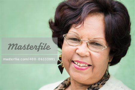 Portrait of happy old african american woman with glasses and wig smiling at camera Stock Photo - Budget Royalty-Free, Image code: 400-06333881