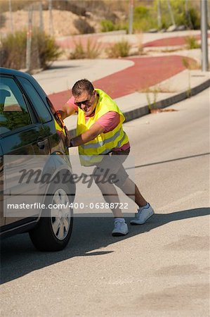 Having to push uphill after a breakdown Stock Photo - Budget Royalty-Free, Image code: 400-06388722