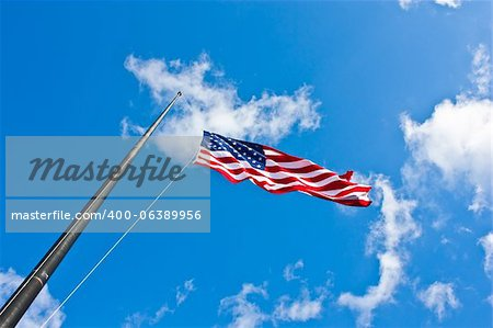 American flag on a blue sky during a windy day Stock Photo - Budget Royalty-Free, Image code: 400-06389956