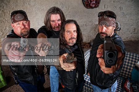 Group of four bikers in leather jackets brandishing weapons Stock Photo - Budget Royalty-Free, Image code: 400-06396524
