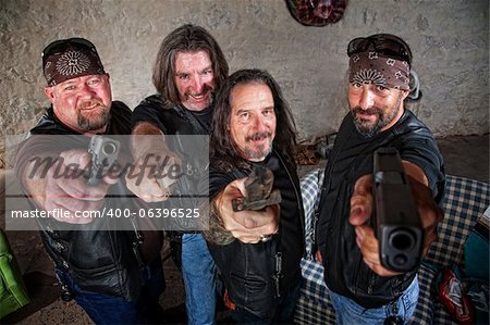 Smiling group of Caucasian bikers in leather jackets with weapons Stock Photo - Budget Royalty-Free, Image code: 400-06396525