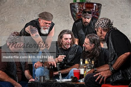 Biker gang members talking and drinking with weapons Stock Photo - Budget Royalty-Free, Image code: 400-06396529