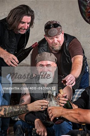 Smiling gang members toasting with bottle of liquor Stock Photo - Budget Royalty-Free, Image code: 400-06396531