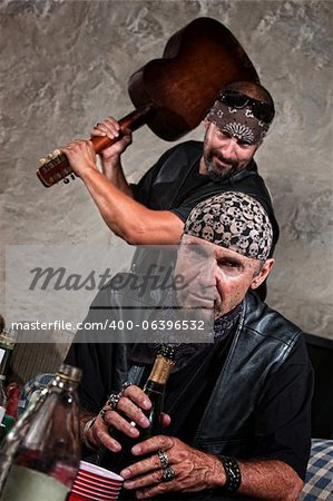 Gang member with guitar about to attack man sitting Stock Photo - Budget Royalty-Free, Image code: 400-06396532