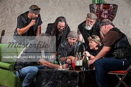 Seven biker gang members writing a plan indoors Stock Photo - Budget Royalty-Free, Image code: 400-06396533