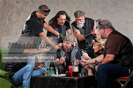 Biker gang members threatening man in bandana Stock Photo - Budget Royalty-Free, Image code: 400-06396534