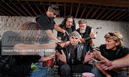Group of bikers in leather hold up sitting man Stock Photo - Budget Royalty-Free, Image code: 400-06396536