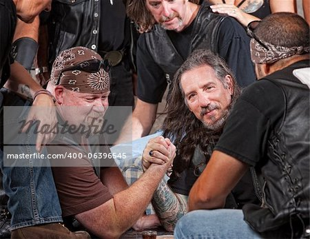 Tough male gang members in arm wrestling match Stock Photo - Budget Royalty-Free, Image code: 400-06396545