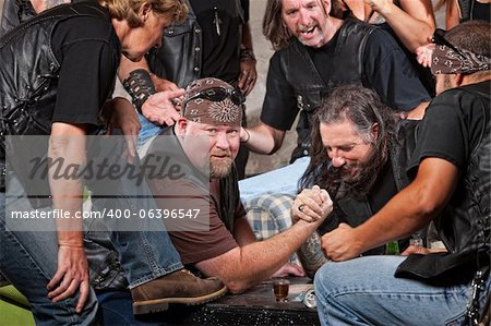 Big man in biker gang losing arm wrestling match Stock Photo - Budget Royalty-Free, Image code: 400-06396547