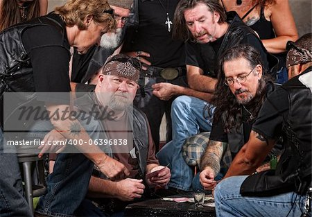 Serious gang members playing cards and drinking Stock Photo - Budget Royalty-Free, Image code: 400-06396838