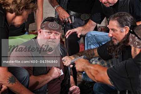 Sneaky gang member caught cheating with playing card in pocket Stock Photo - Budget Royalty-Free, Image code: 400-06396840