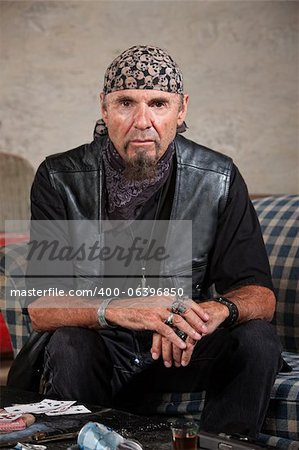 Frowning gang member in leather vest in cold stare Stock Photo - Budget Royalty-Free, Image code: 400-06396850