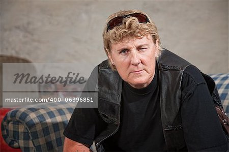 Aggressive white female biker gang member with sunglasses Stock Photo - Budget Royalty-Free, Image code: 400-06396851