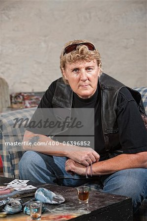 Tough female gang member in black leather jacket and alcohol Stock Photo - Budget Royalty-Free, Image code: 400-06396852