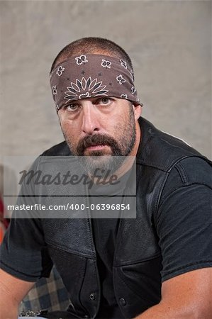 Serious bearded man with bandana and leather vest Stock Photo - Budget Royalty-Free, Image code: 400-06396854