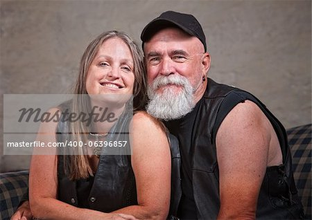 Adorable mature biker couple wearing leather vests Stock Photo - Budget Royalty-Free, Image code: 400-06396857