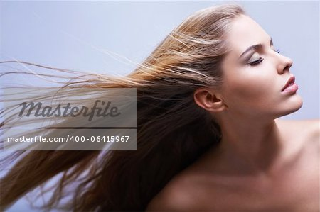 Young beautiful girl with flying hair Stock Photo - Budget Royalty-Free, Image code: 400-06415967