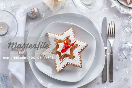 Plate for Christmas evening decorated with small present and gingerbread cookie Stock Photo - Budget Royalty-Free, Image code: 400-06416325