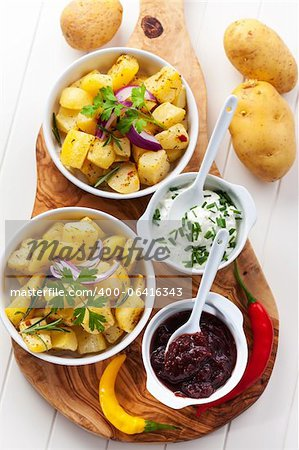 Baked potatoes with chutney and sour cream - top view Stock Photo - Budget Royalty-Free, Image code: 400-06416343