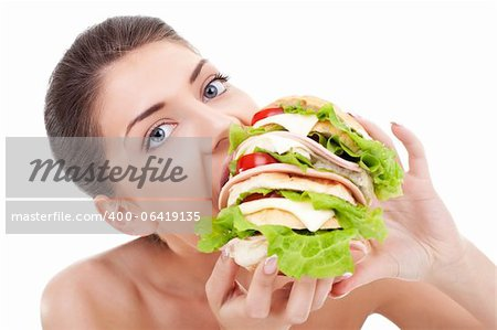 young woman eating a huge sandwich on white background Stock Photo - Budget Royalty-Free, Image code: 400-06419135