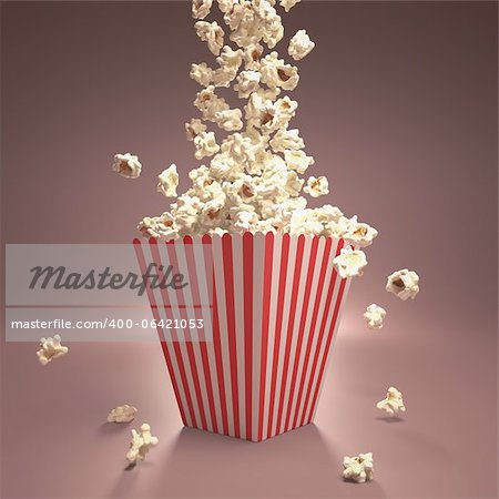 Dropping popcorn in striped classic package. Stock Photo - Budget Royalty-Free, Image code: 400-06421053