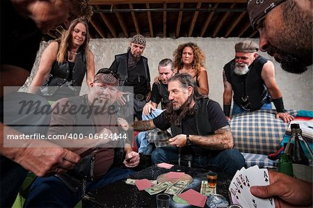Rowdy biker gang gambling and pulling out weapons Stock Photo - Budget Royalty-Free, Image code: 400-06424144
