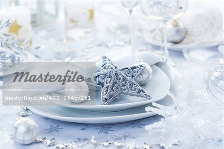 Place setting in white and silver for Christmas with star Stock Photo - Budget Royalty-Free, Image code: 400-06457281