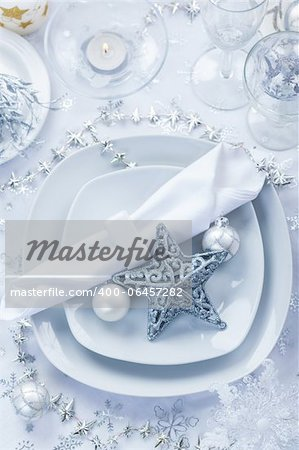Place setting in white and silver for Christmas with star Stock Photo - Budget Royalty-Free, Image code: 400-06457282