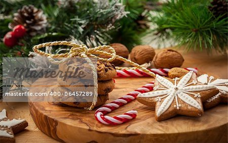Christmas nut and chocolate cookies with candy cane Stock Photo - Budget Royalty-Free, Image code: 400-06457289