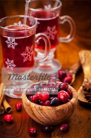 Cranberries in wooden bowl with hot mulled wine Stock Photo - Budget Royalty-Free, Image code: 400-06461723