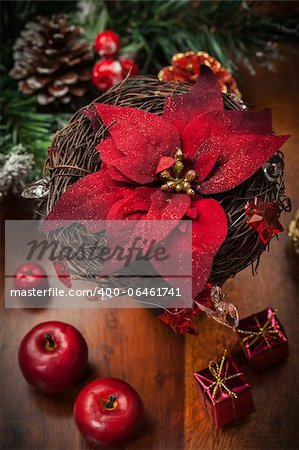 Christmas flower with decoration on wooden table Stock Photo - Budget Royalty-Free, Image code: 400-06461741