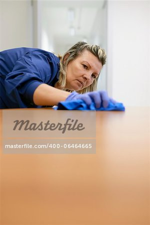 Woman at work, professional maid cleaning desk in office. Copy space Stock Photo - Budget Royalty-Free, Image code: 400-06464665