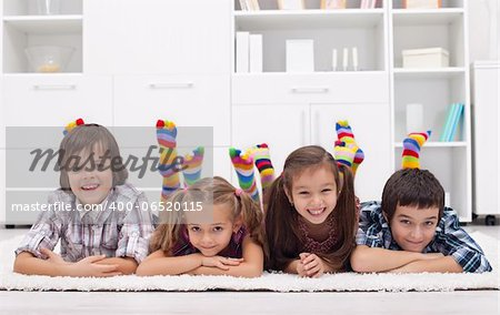Children laying on the floor wearing colorful socks Stock Photo - Budget Royalty-Free, Image code: 400-06520115