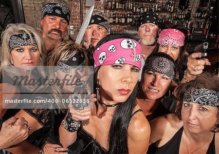 Threatening motorcycle gang members with gun and knife Stock Photo - Budget Royalty-Free, Image code: 400-06522838