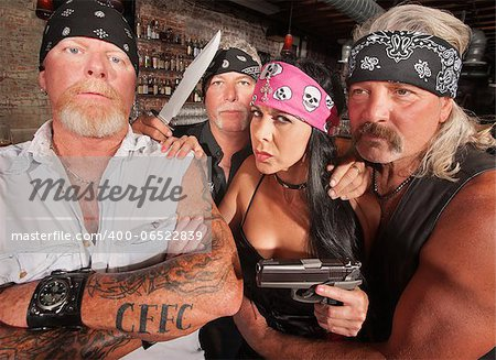 Four tough motorcycle gang members with weapons in tavern Stock Photo - Budget Royalty-Free, Image code: 400-06522839