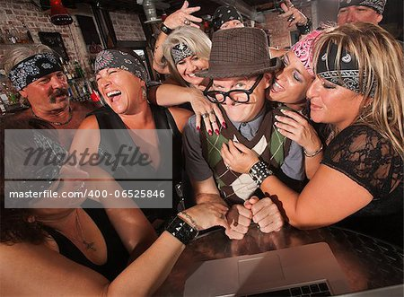 Excited male nerd with adoring female biker gang Stock Photo - Budget Royalty-Free, Image code: 400-06525846