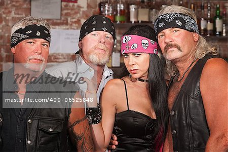 Tough male biker gang members with beautiful woman Stock Photo - Budget Royalty-Free, Image code: 400-06525848