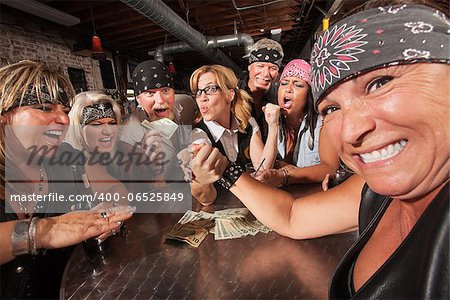 Tough female losing an arm wrestling contest with nerd Stock Photo - Budget Royalty-Free, Image code: 400-06525849