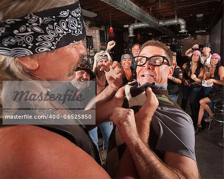 Nerd threatening tough gang member grabbing him by the collar Stock Photo - Budget Royalty-Free, Image code: 400-06525850
