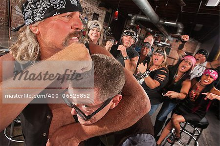 Bearded gang member holding nerd in a head lock Stock Photo - Budget Royalty-Free, Image code: 400-06525852