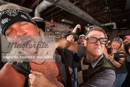 Confident geek punches mature biker gang man on chin Stock Photo - Budget Royalty-Free, Image code: 400-06525854
