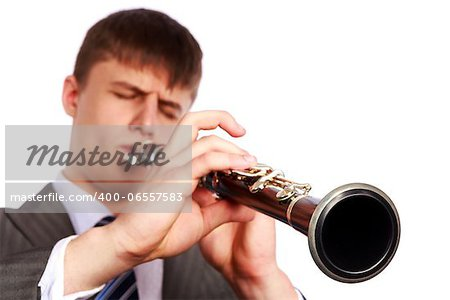 Young musician plays the clarinet on a white background Stock Photo - Budget Royalty-Free, Image code: 400-06557583