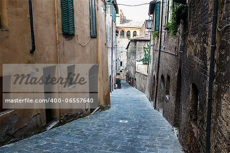 Narrow Alley With Old Buildings In Medieval Town of Siena, Tuscany, Italy Stock Photo - Budget Royalty-Free, Image code: 400-06557640