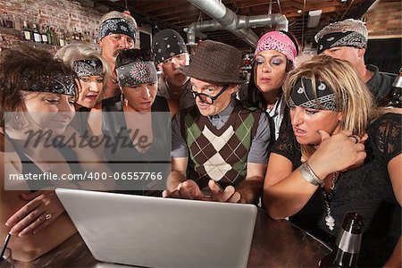 Group of impressed biker gang members watching nerd using a computer Stock Photo - Budget Royalty-Free, Image code: 400-06557766