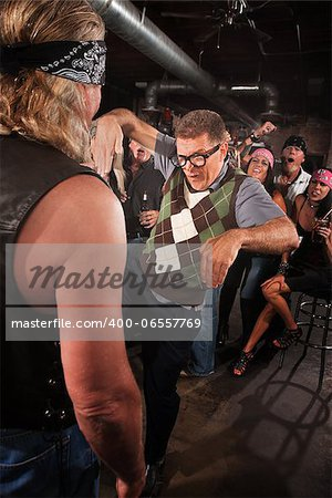 Nerd threatening strong gang member with martial arts Stock Photo - Budget Royalty-Free, Image code: 400-06557769
